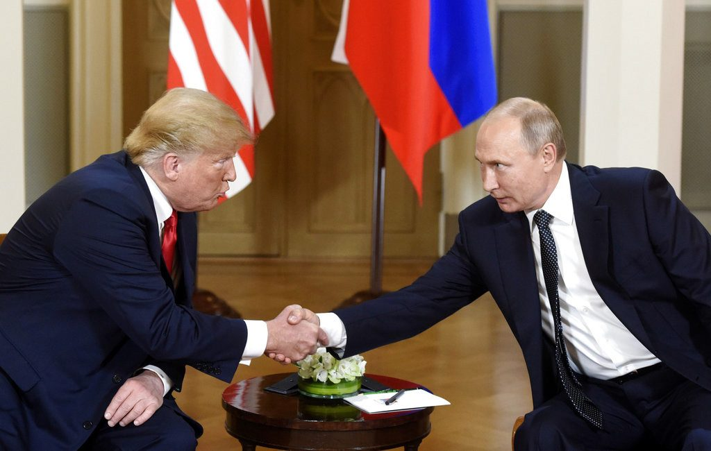 President Trump and Russian President Vladimir Putin shake hands during their meeting in the Presidential Palace in Helsinki on Monday.
