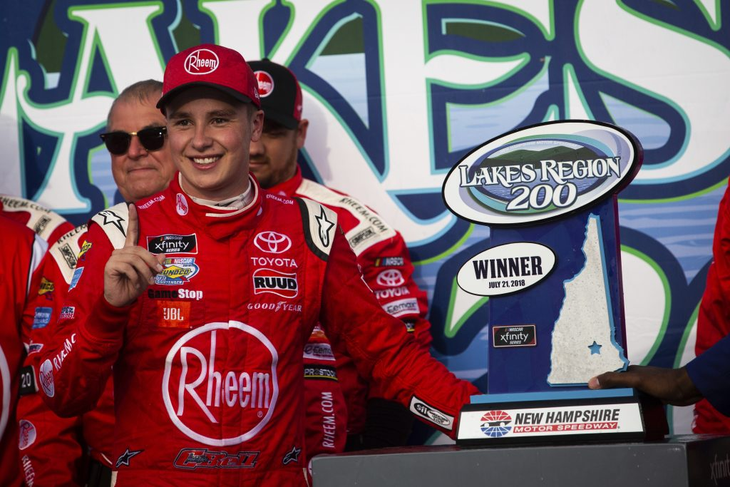 Christopher Bell stands next to the trophy after winning the NASCAR Xfinity Series race Saturday at New Hampshire Motor Speedway in Loudon, N.H.