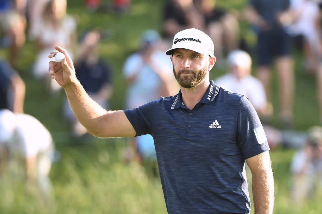 Dustin Johnson salutes the crowd on the 18th green after winning the Canadian Open on Sunday at the Glen Abbey Golf Club in Oakville, Ontario.