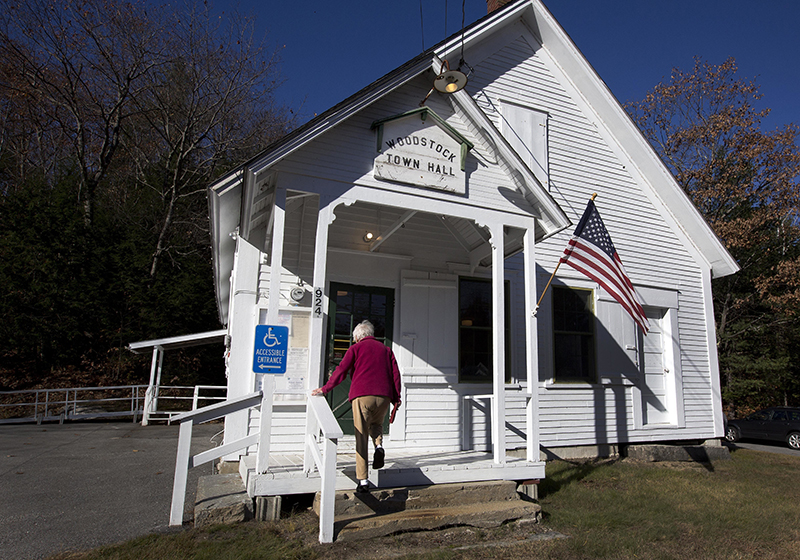 A voter arrives to vote at the Woodstock, N.H. town hall Tuesday, Nov. 8, 2016.