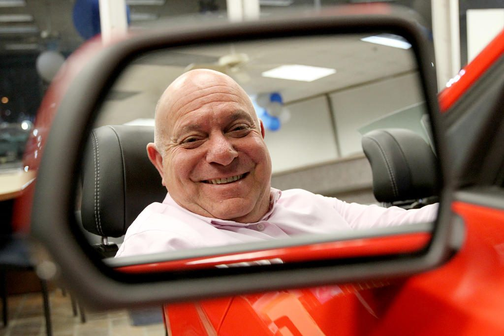 General Manager Bob Esposito behind the wheel at Yankee Ford in South Portland. Esposito is also managing partner of the dealership and two others in Brunswick and Rockland.