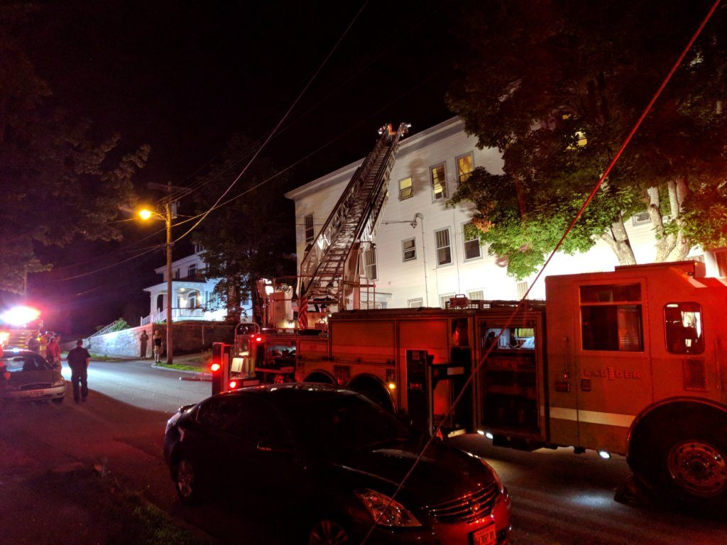 Firefighters investigate a small fire at an apartment house at 18 Bradley St. in Lewiston late Friday night.