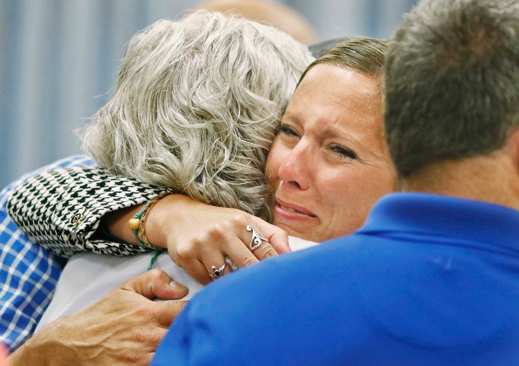 Jill Lamontagne hugs family members after being found not guilty by a jury of sexually assaulting a former student, at York County Superior Court in Alfred on Thursday.