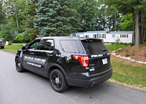 Topsham police respond to the home on Raymond Road where a toddler from Wiscasset was attacked by a dog Tuesday evening.