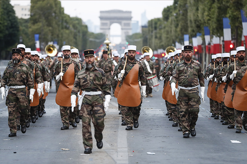 Soldiers of the French Foreign Legion parade on the Champs Élysées avenue during a rehearsal for Bastille Day on Wednesday in Paris.