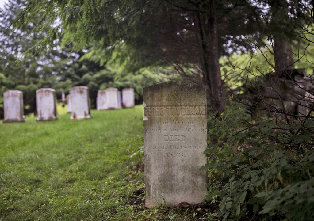 Pedro Tovookan Parris' gravestone sits off to the side in a private graveyard where the rest of the Parris family is also buried. He died at 27 of pneumonia.