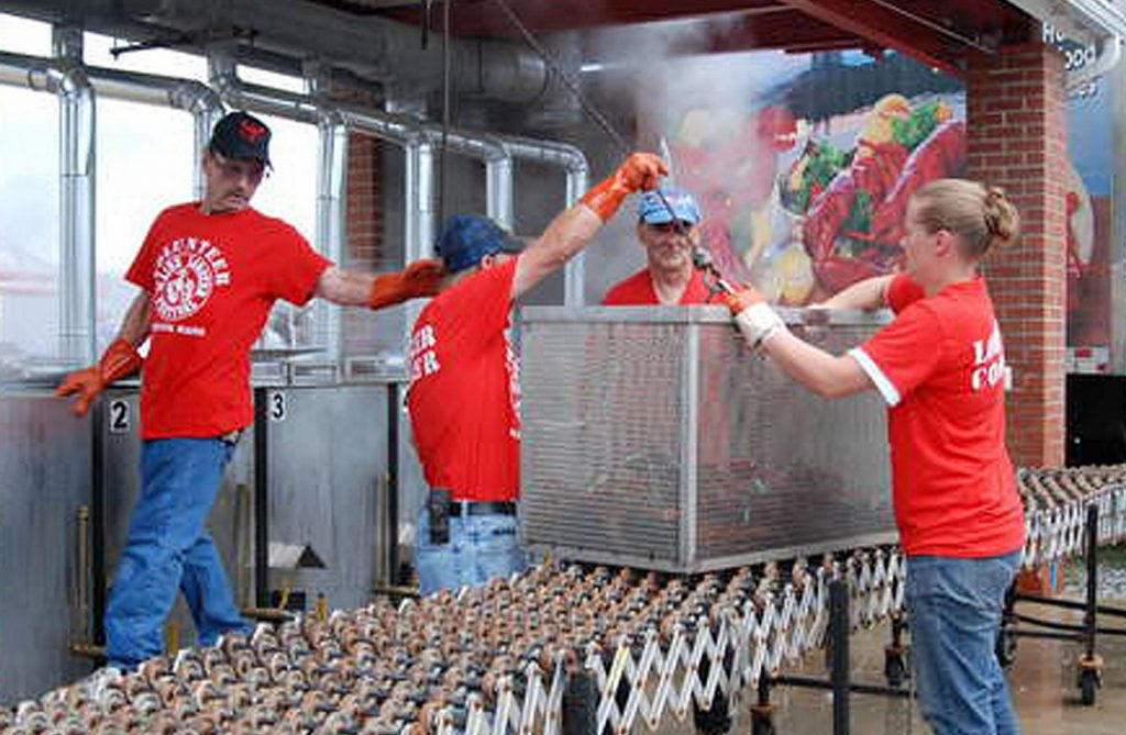 Cookers load another batch at the 71st Lobster Festival in Rockland.
