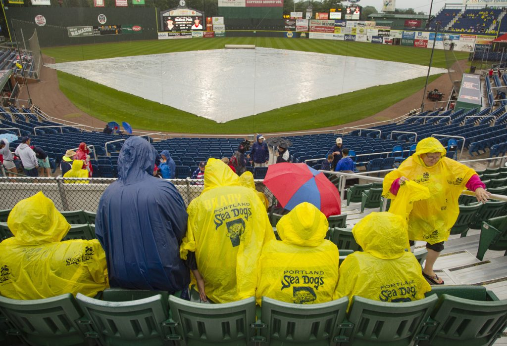 Portland Sea Dogs fans wait in their seats at Hadlock Field before Wednesday's game against the Erie SeaWolves was postponed because of rain. The teams will play a doubleheader Thursday.