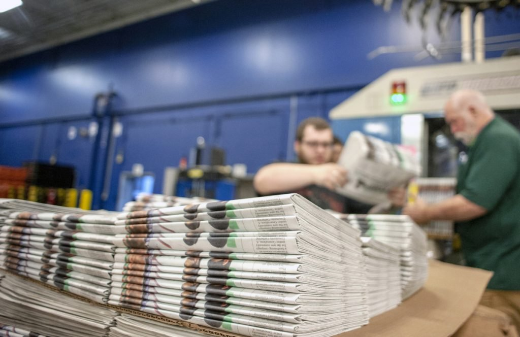 Workers stack newspapers at the Janesville Gazette printing plant in Janesville, Wis. Newsprint is usually a paper's second-biggest expense after employee wages.