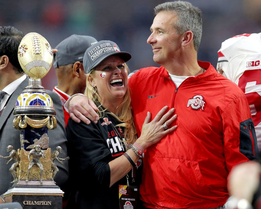 An assistant coach's wife told Shelley Meyer, left, she had been assaulted by her husband, a member of Urban Meyer's staff at Ohio State. Meyer says he did not know about that conversation. The school put him on leave and is investigating the incident.