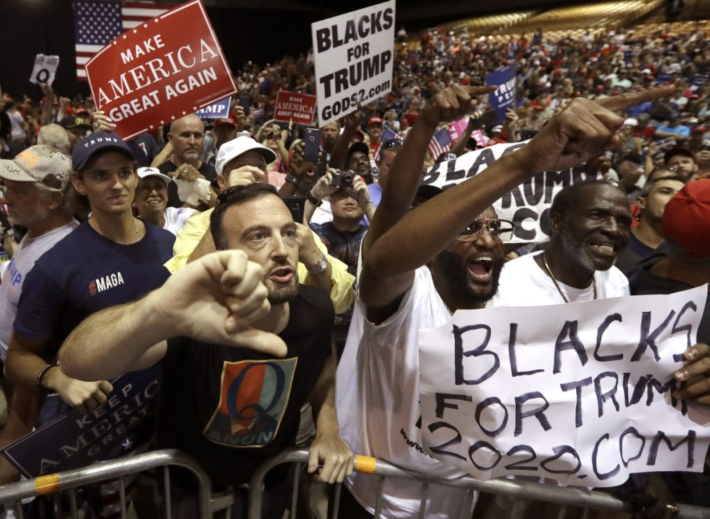 Supporters of President Trump shout down a CNN news crew in July before a rally in Tampa, Fla.