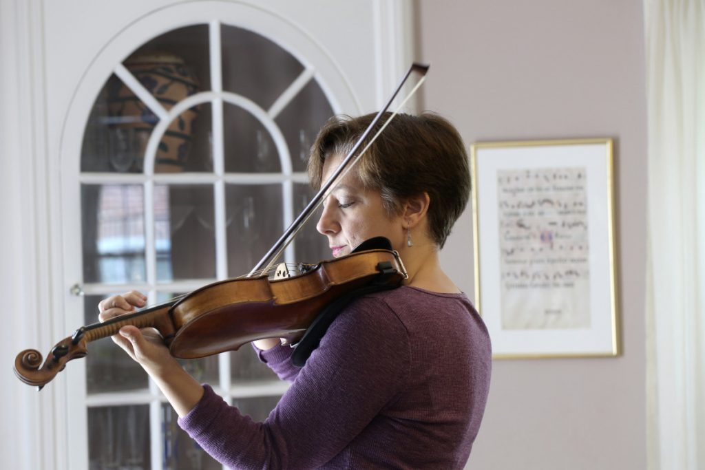 Jenny Elowitch, at home in Natick, MA, retires after this season as artistic director of the Portland Chamber Music Festival. She co-founded the festival 25 years ago.