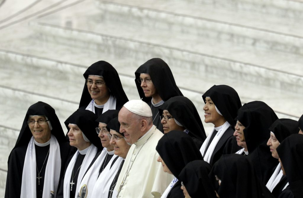 Pope Francis poses with nuns at the Vatican on Wednesday. Advocates say expanding the ministry would give women a greater role, while also helping address effects of the priest shortage in some parts of the world.