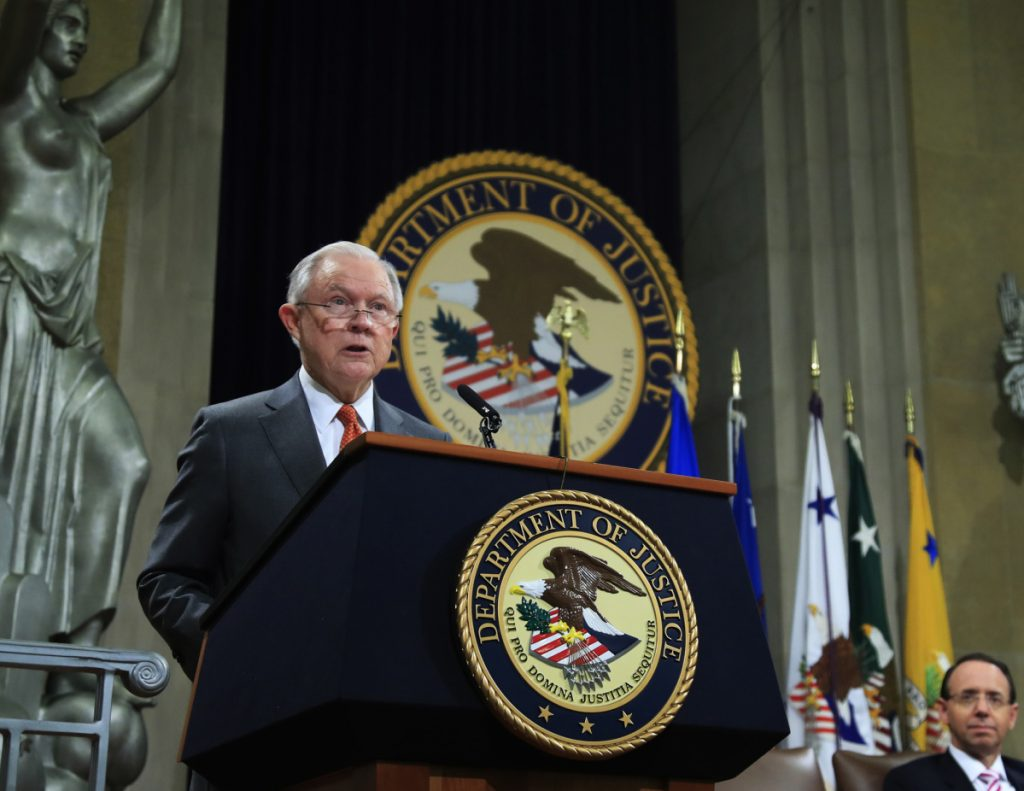 Attorney General Jeff Sessions speaks during a Religious Liberty Summit at the Department of Justice on Monday. Seated on the right is Deputy Attorney General Rod Rosenstein.