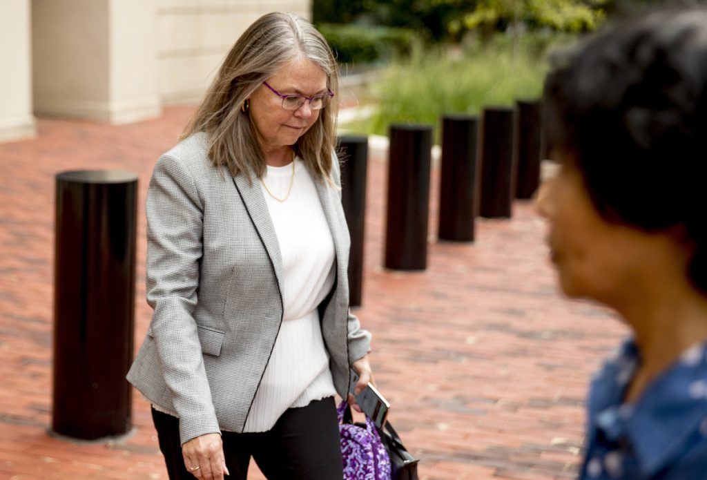 Tax preparer Cindy Laporta leaves the Alexandria Federal Courthouse in Alexandria, Va., on Friday, after testifying under immunity in the fourth day of the trial of President Trump's former campaign chairman Paul Manafort.