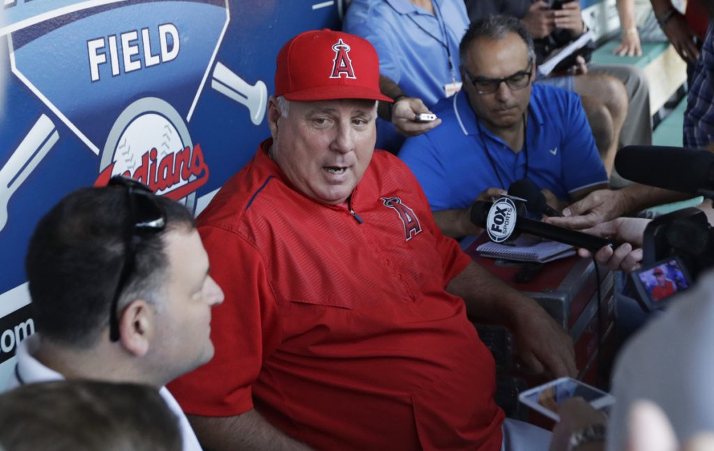 """Angels Manager Mike Scioscia denies a report that he will retire at the end of the season, calling it """"poppycock."""" Scioscia has managed the Angels for 19 seasons."""