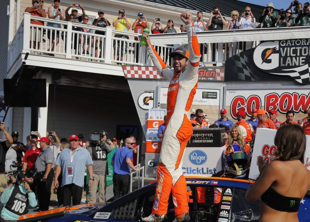 Chase Elliott, center, celebrates after holding off Martin Truex Jr. to earn his first NASCAR Cup Series win on Sunday in Watkins Glen, New York.