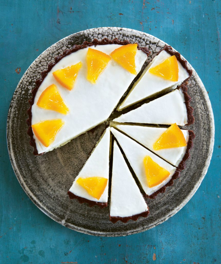 Before serving Ginger-Chocolate & Orange Frozen Tart, place it in the fridge for 30 minutes to soften slightly.