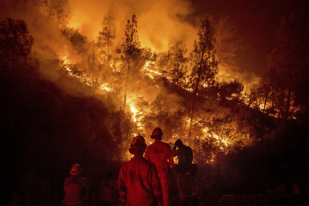 Firefighters monitor a backfire while battling the Ranch Fire, part of the Mendocino Complex, on Tuesday near Ladoga, Calif.