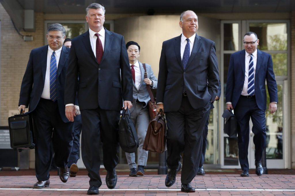 The defense team for Paul Manafort, including Kevin Downing, front left, and Thomas Zehnle, right, arrive at federal court in Alexandria, Va., on Wednesday for the continuation of the trial of the former Trump campaign chairman.