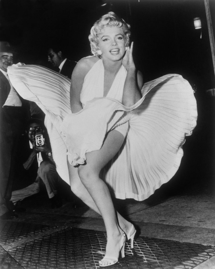 """Marilyn Monroe poses over the updraft of a New York subway grate while filming """"The Seven Year Itch"""" in New York in 1954."""