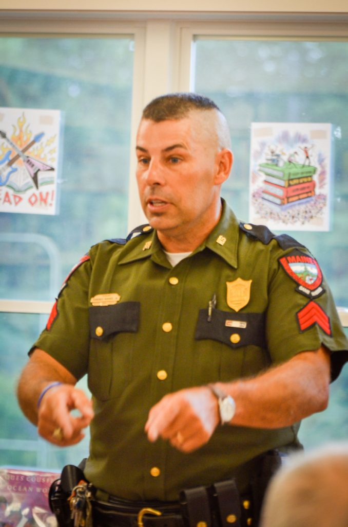 Maine game warden Sgt. Terry Hughes speaks on Wednesday at the Belgrade Public Library about the discovery and arrest of Christopher Knight, the North Pond Hermit.