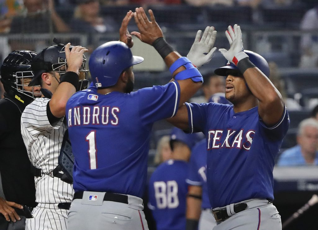 Texas Rangers' Adrian Beltre, right, is congratulated by Elvis Andrus (1) after hitting a two-run home run against the New York Yankees during the fourth inning of a baseball game Friday, Aug. 10, 2018, in New York. ()