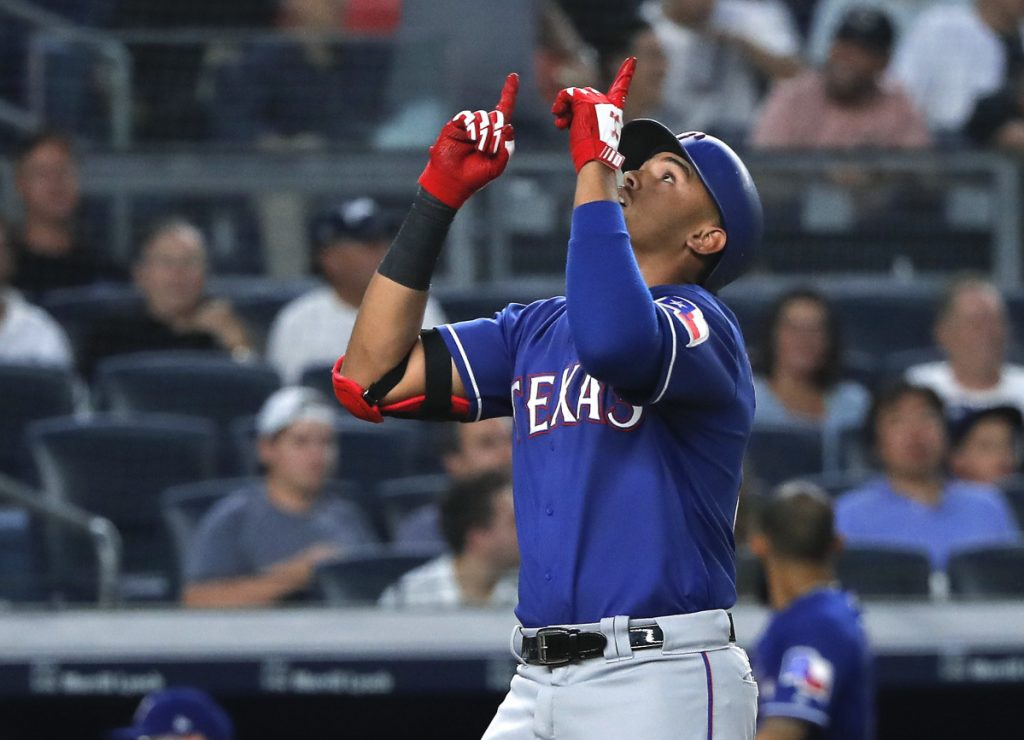 Ronald Guzman of the Texas Rangers celebrates while crossing the plate after hitting a home run in the fourth inning Friday night against the New York Yankees.