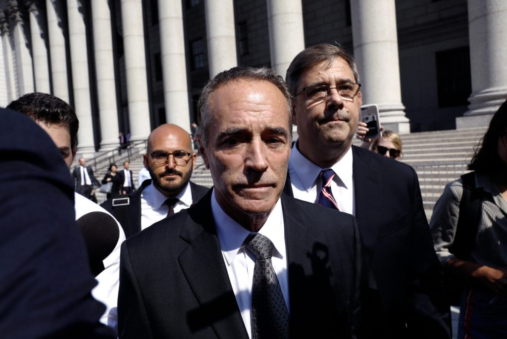 Bloomberg/Peter Foley   Rep. Christopher Collins, a Republican from New York, exits federal court in New York on Aug. 8, 2018.