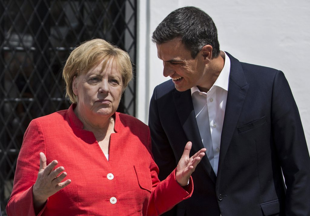 Spain's Prime Minister Pedro Sanchez speaks with German Chancellor Angela Merkel in Sanlucar de Barrameda in southern Spain on Saturday.
