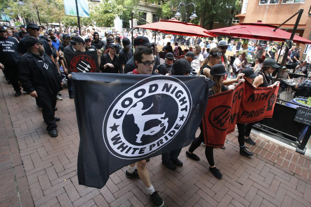 """A group of anti-fascism demonstrators march in downtown Charlottesville, Va., on Saturday in anticipation of the anniversary of last year's """"Unite the Right"""" protest that killed one."""