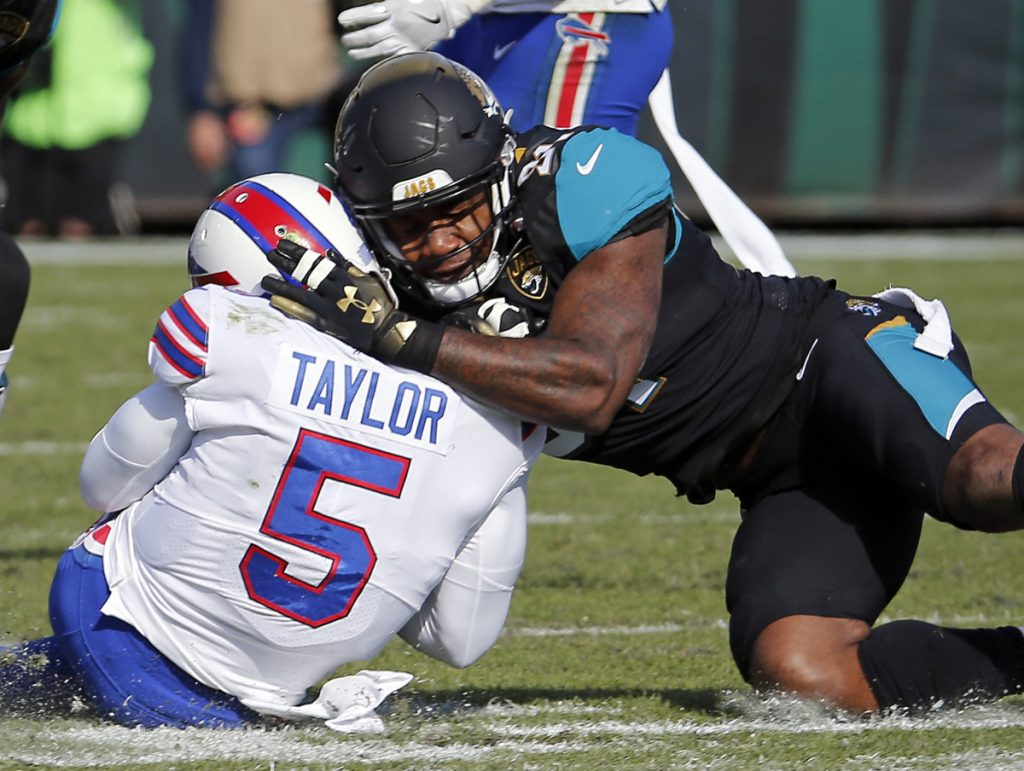 Jaguars defensive end Yannick Ngakoue, shown here tackling Bills quarterback Tyrod Taylor last season, had to be separated from teammate Dante Fowler multiple times after practice on Sunday.