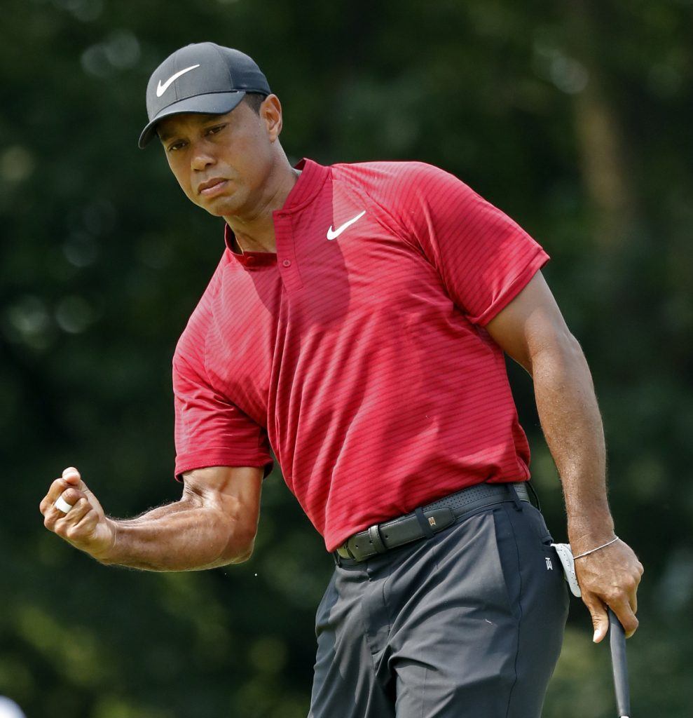 Tiger Woods celebrates after sinking a birdie putt on the ninth hole Sunday during the final round of the PGA Championship. Woods settled for second place despite closing with a 6-under 64.