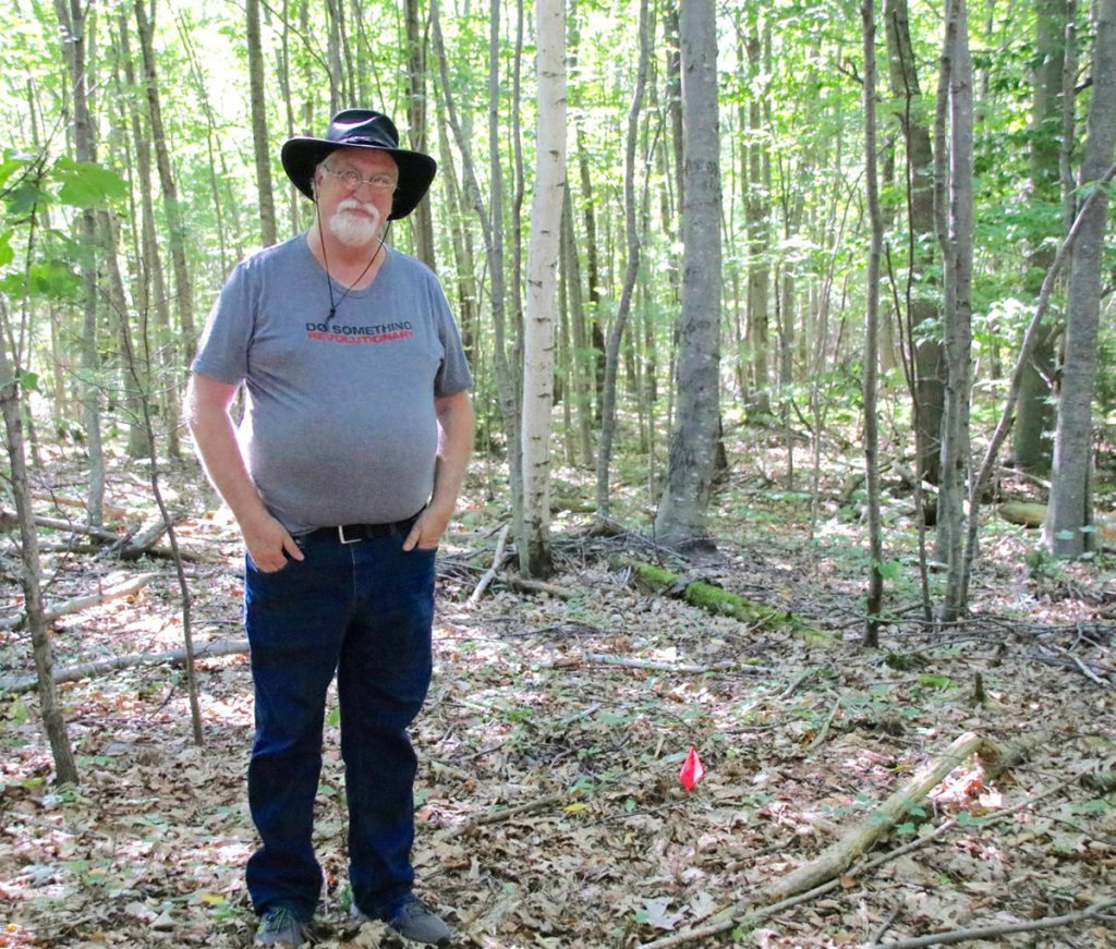 Dana Peterson, of Sanford, stands in a location in the southern part of the city where his research tells him a 1744 garrison may have been located. He and archeologists and volunteers plan to dig a series of holes this weekend and look for artifacts consistent with a garrison. The small flag in the photo shows where one of the small pits will be dug.