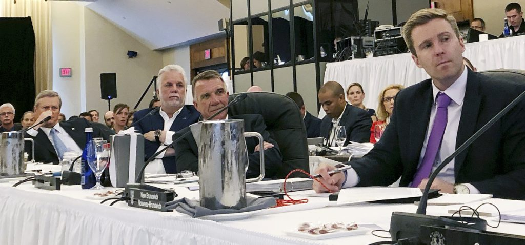 Massachusetts Gov. Charlie Baker, left, Quebec Premier Phillippe Couillard, Vermont Gov. Phil Scott and New Brunswick Premier Brian Gallan attend the Conference of New England Governors and Eastern Canadian Premiers.