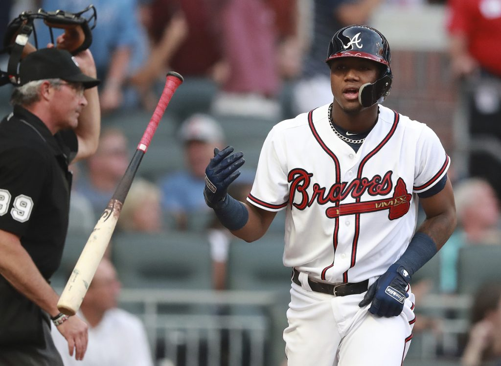 The Braves' Ronald Acuna Jr. flips his bat after hitting a first-inning homer against Miami on Tuesday. Acuna, 20, became the youngest player to homer in five straight games.