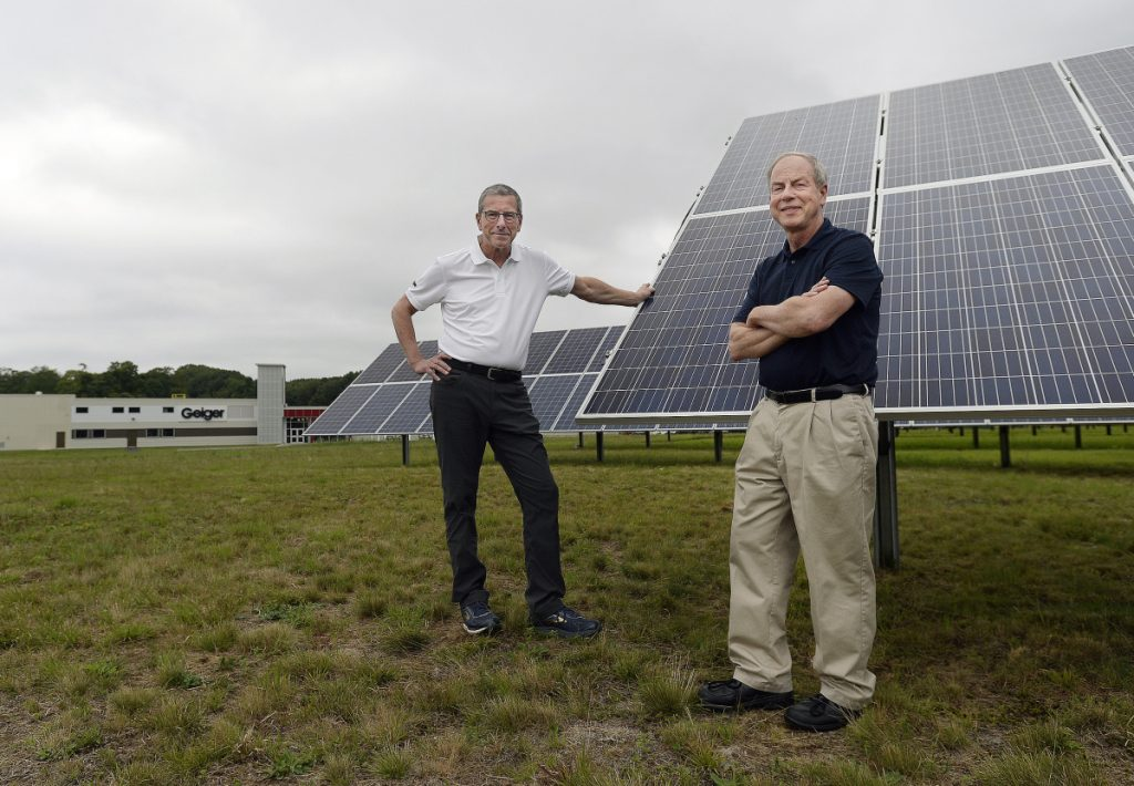 Brothers Gene, left, and Peter Geiger stand near the solar panels at Geiger in Lewiston. The Geigers publish the Farmers' Almanac.