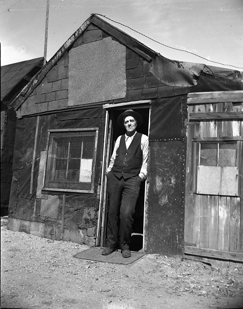 """Bill Powers outside his Portland shack in 1938, after city councilors voted to raze the structure built on Back Cove. A reader takes issue with the caption that ran online referring to the """"Back Bay."""""""