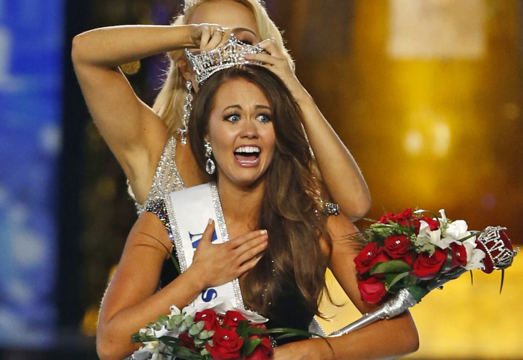 Miss North Dakota Cara Mund reacts after being named Miss America during the Miss America 2018 pageant in Atlantic City, N.J., in 2017. In a letter sent to former Miss Americas on Friday, Mund says she has been bullied, manipulated and silenced by the pageant's current leadership, including chairwoman Gretchen Carlson.