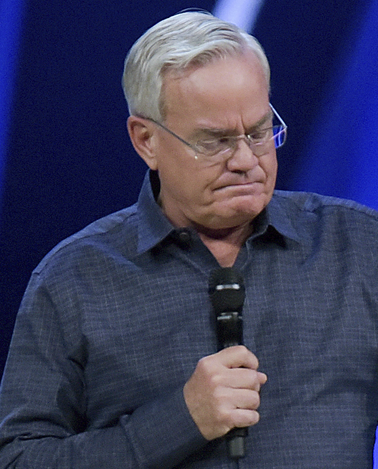 Willow Creek Community Church Senior Pastor Bill Hybels stands before his congregation April 10 in South Barrington, Ill., where he announced his early retirement.