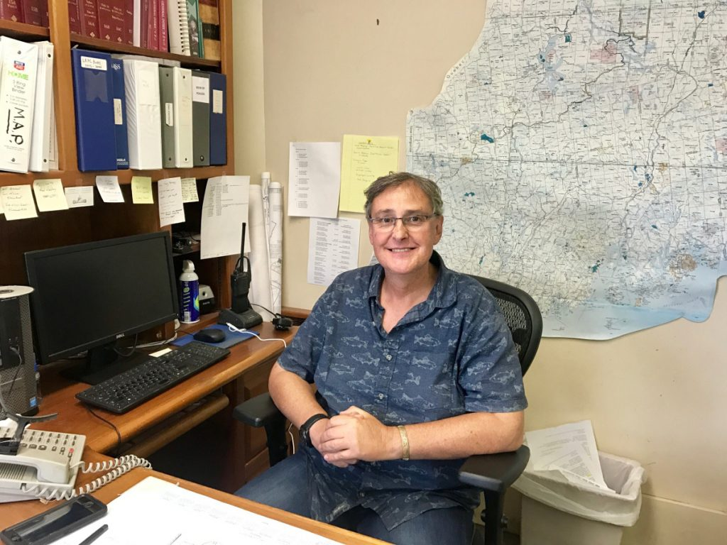 Oakland Town Manager Gary Bowman, pictured at his office Friday, said he was under stress when he decided Wednesday to resign from the job, but took back the decision Thursday.