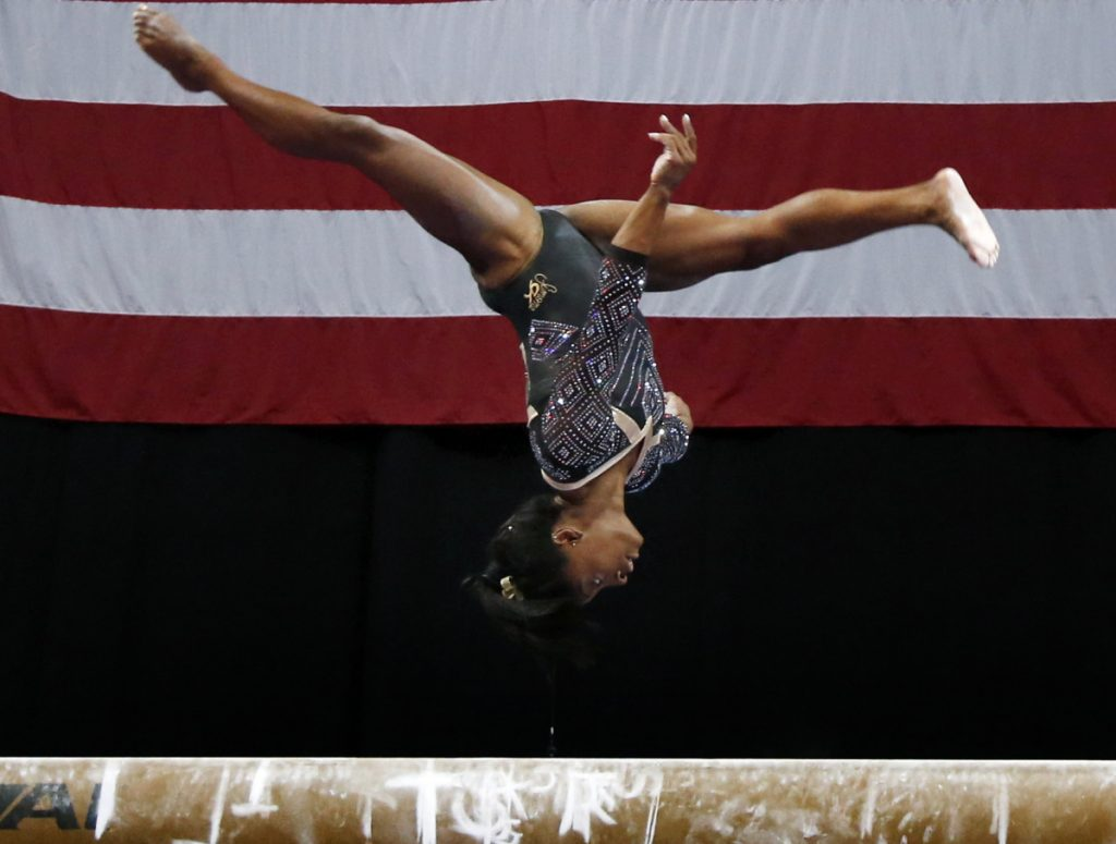Simone Biles posted the best score in the balance beam as well as the other three events Friday on the first day of the women's competition at the U.S. Championships in Boston.