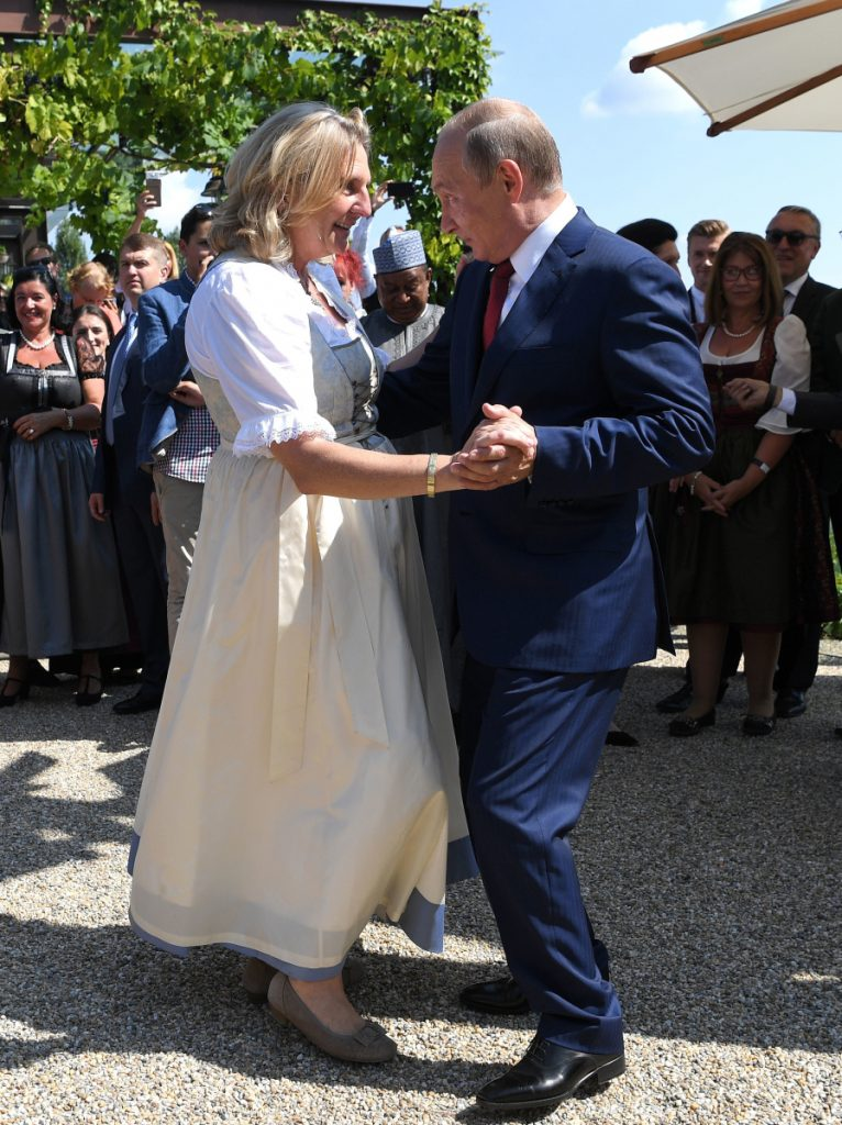 Russian President Vladimir Putin dances with Austrian Foreign Minister Karin Kneissl at her wedding in Gamlitz, southern Austria, on Saturday. He brought a small Cossack men's choir along to entertain about 100 guests.