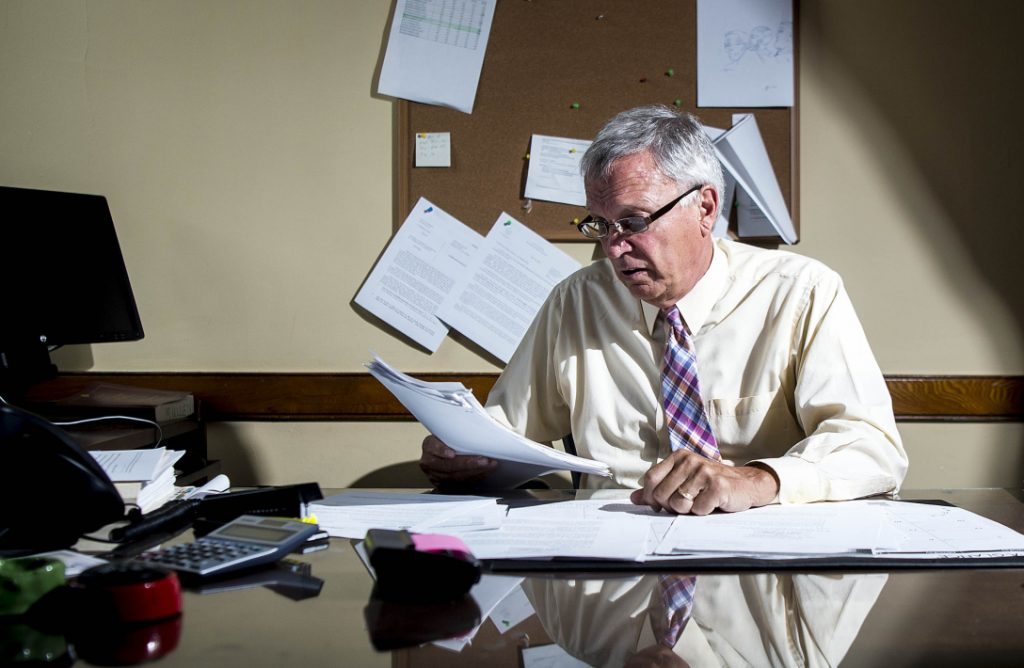 Justice Robert Mullen reviews juror paperwork in his chambers at the Somerset Superior Court on Friday.