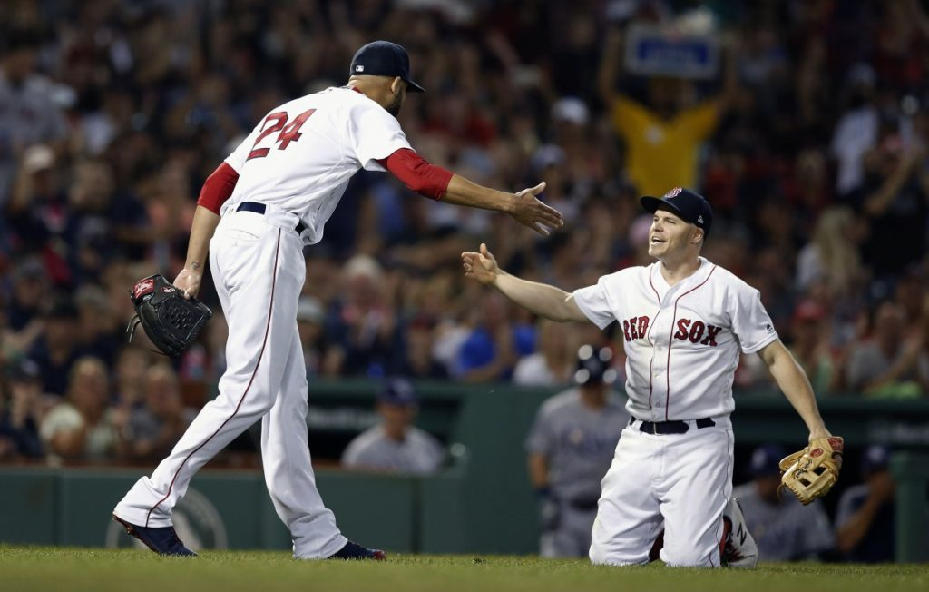 Red Sox pitcher David Price celebrates the out made by third baseman Brock Holt on a bunt attempt by Tampa Bay's Carlos Gomez. Price remained unbeaten since the All-Star break as the Red Sox won, 5-2.