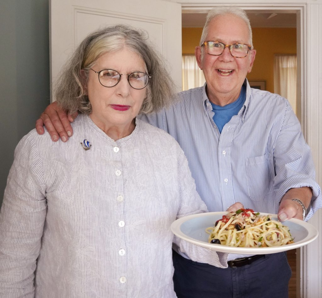 "Peter and Terry Weyl with a plate of Marco Polo Spaghetti at their Portland home on Monday. ""Tuna? Swiss cheese? Not what you might expect, but darned tasty,"" Terry Weyl says of the dish."