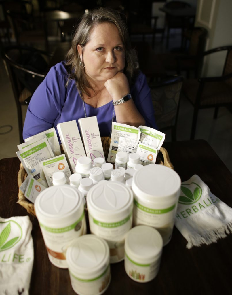 """Patricia Rodgers and her husband, Jeff, residents of Hallandale Beach, Fla., say they lost over $100,000 as distributors of Herbalife products, including about $20,000 spent on attending company """"Circle of Success"""" events promising riches that never materialized."""