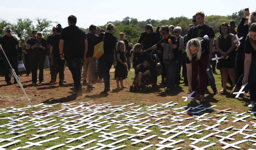 People place white crosses, representing farmers killed in the country, at a ceremony at the Vorrtrekker Monument in Pretoria, South Africa, in 2017.