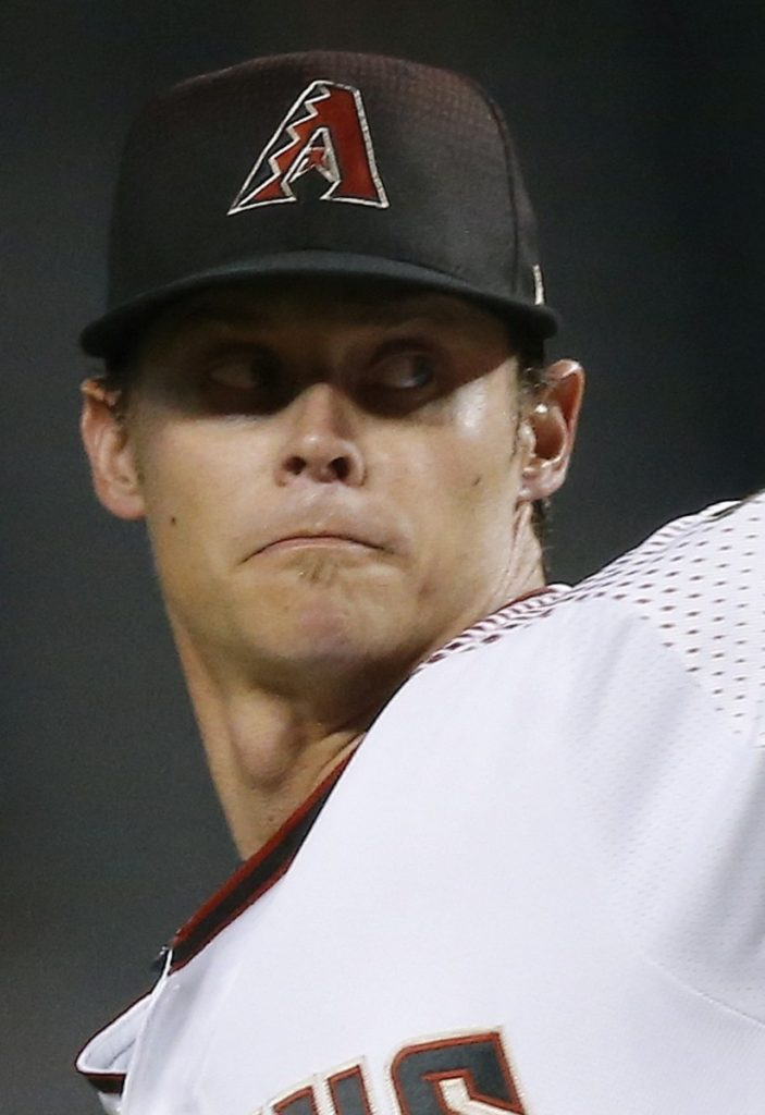 Arizona Diamondbacks starter Clay Buchholz throws a pitch to a  Los Angeles Angels batter during the first inning of a baseball game Wednesday, Aug. 22, 2018, in Phoenix. (AP Photo/Ross D. Franklin)