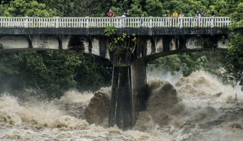The Wailuku River rages below a bridge in Hilo, Hawaii, on Thursday, as torrents of rain blew in with Hurricane Lane. As much as 35 inches of rain fell in 48 hours.